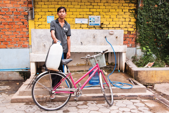 Young man bikes to CCF #5 to get clean water