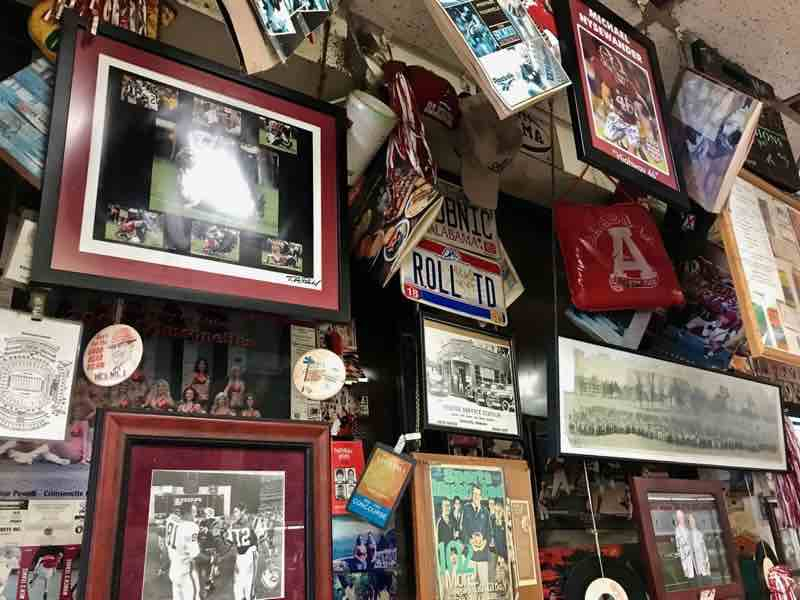 Heavily covered walls with Crimson Tide memorabilia | nevertooldtotravel.com | Gary House