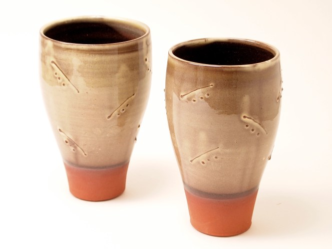 Slipware beakers with slip trailed decoration