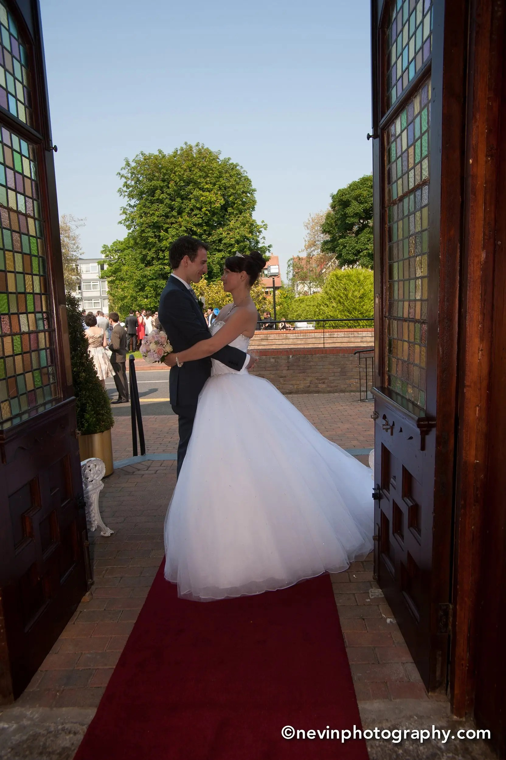 Bride and groom embrace at Thomas Prior Hall