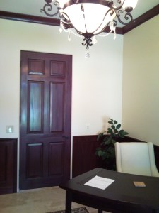 Painted door was wood grained to match natural mahogany wainscot