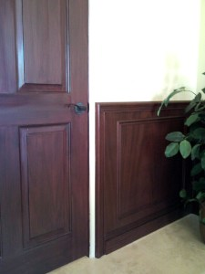 White door wood grained to match newly installed mahogany wainscot