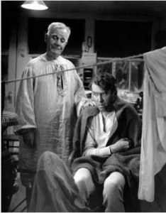 Clarence the Angel (Henry Travers) and George Bailey (James Stewart) in IT'S A WONDERFUL LIFE.