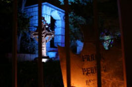 house at haunted hill cemetery gate