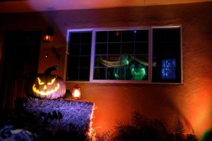 house at haunted hill pumpkin and window with ghosts