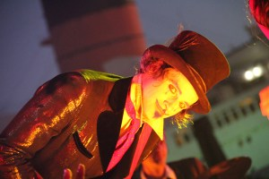 An evil Master of Ceremonies presides of Dark Harbor at the Queen Mary