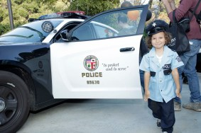 A young trick-or-treater, dressed as one of L.A.'s finest.