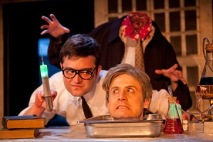 Graham Skipper as Herbert West with the decapitated Dr. Hill (Jesse Merlin). Photo by Thomas Hargis.