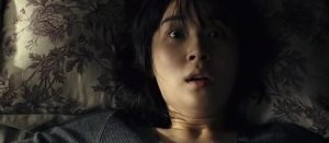 Yun-hee wakes up from one of her scary dreams.