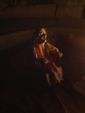 Strange miniature witch in the fire pit in the yard of Delusion: His Crimson Queen