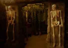 Skeletons guard the entrance to a wicked wonderland.