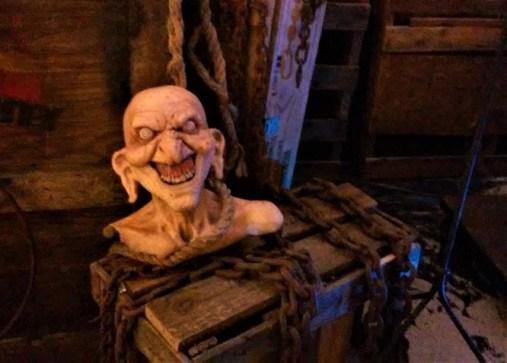 Happy head atop a pirate treasure trunk