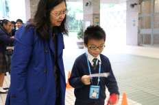 Ms. Liu with a primary student.