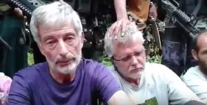 Robert Hall and John Ridsdel (right) were killed by Abu Sayyaf gunmen in the Philippines.