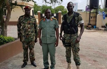 File photo: Lual Akeen (Right) standing with former army chief Paul Malong (middle). (Radio Tamazuj)