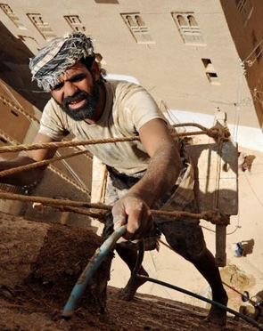 Building repair in Shibam, Yemen
