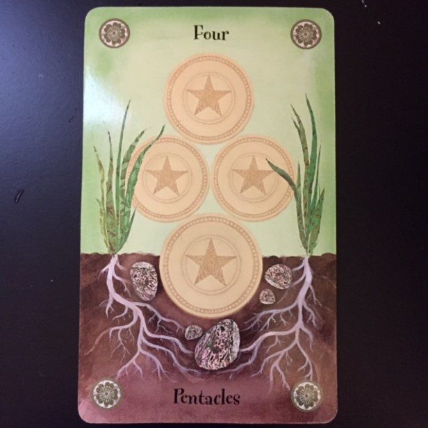 Four of Coins card