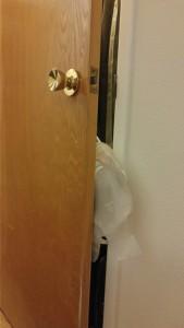 Ostomy Bags on a Closet Door