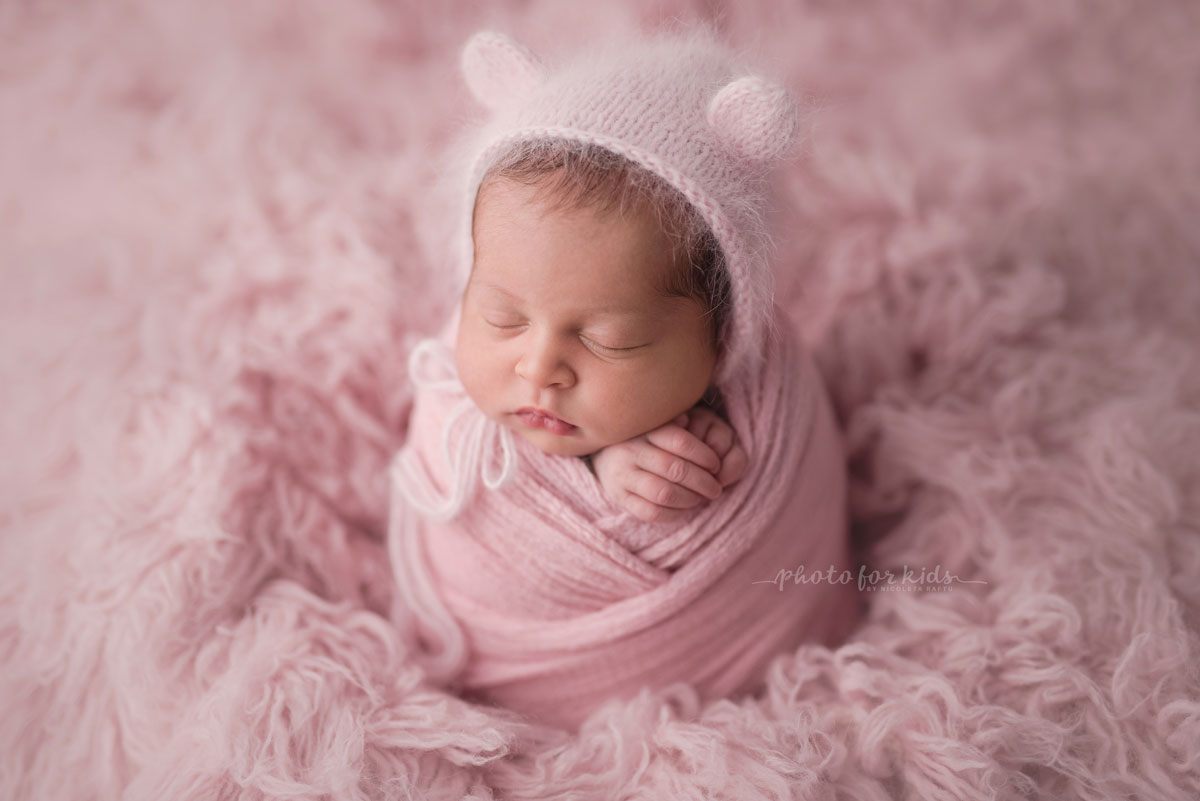 pink all over new born baby girl sleeps during a photography workshop by Nicoleta Raftu