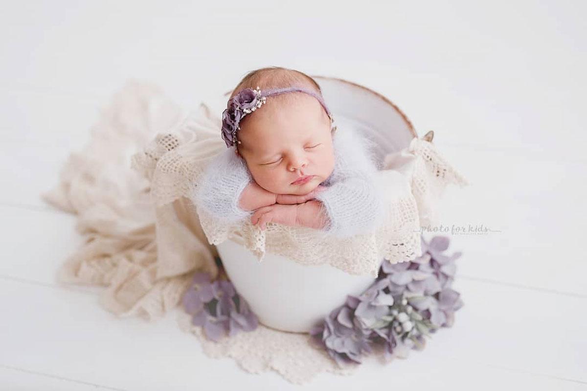 Nicoleta Raftu maternity and new born photographer for workshops by Carmen Bergmann Studio new born sleeps in white wrap