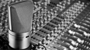 Microphone in front of mixing console