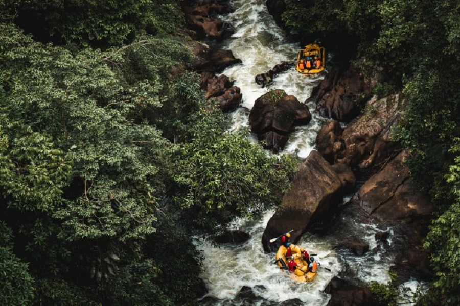 Two yellow rafts going through rapids