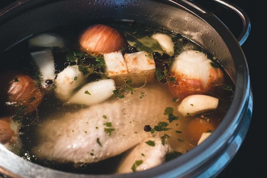 Chicken broth with onions, garlic and bay leaves