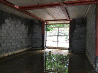During June the ground floor looks more like a series of indoor pools!