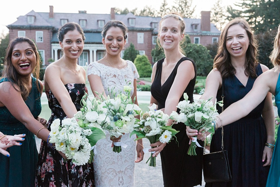 bride and bridesmaids with bouquets at gardens at elm bank