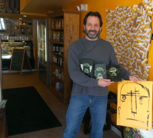 Photo of Warren Croce preparing to hide artwork.