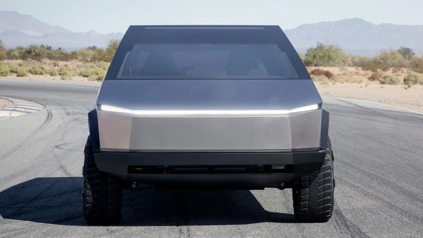 Tesla Cybertruck Electric Pickup Truck Head On View with Headlamps Illuminated