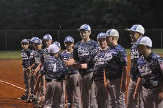 Aiden Zimmerman(#1) is greeted by teammates during introductions prior to Friday's Dixie League O-Zone games at Franklin County's Waid Park.