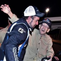 Looney is proudly greeted by his dad, Ronnie Looney, after he won the Track Late Model Championship 2019.