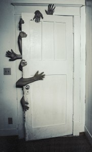 Creepy hands behind door