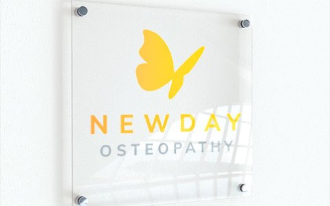 New Day Osteopathy wall plaque