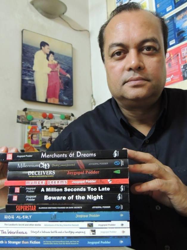 Joygopal Podder with 11 of his books