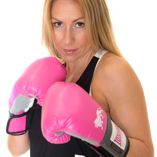 female personal trainer wearing boxing gloves