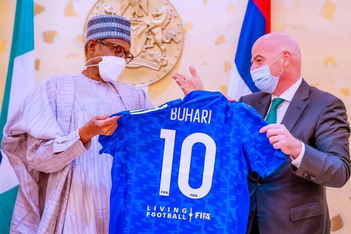 Buhari Gets No.10 Jersey As He Receives FIFA, CAF Presidents