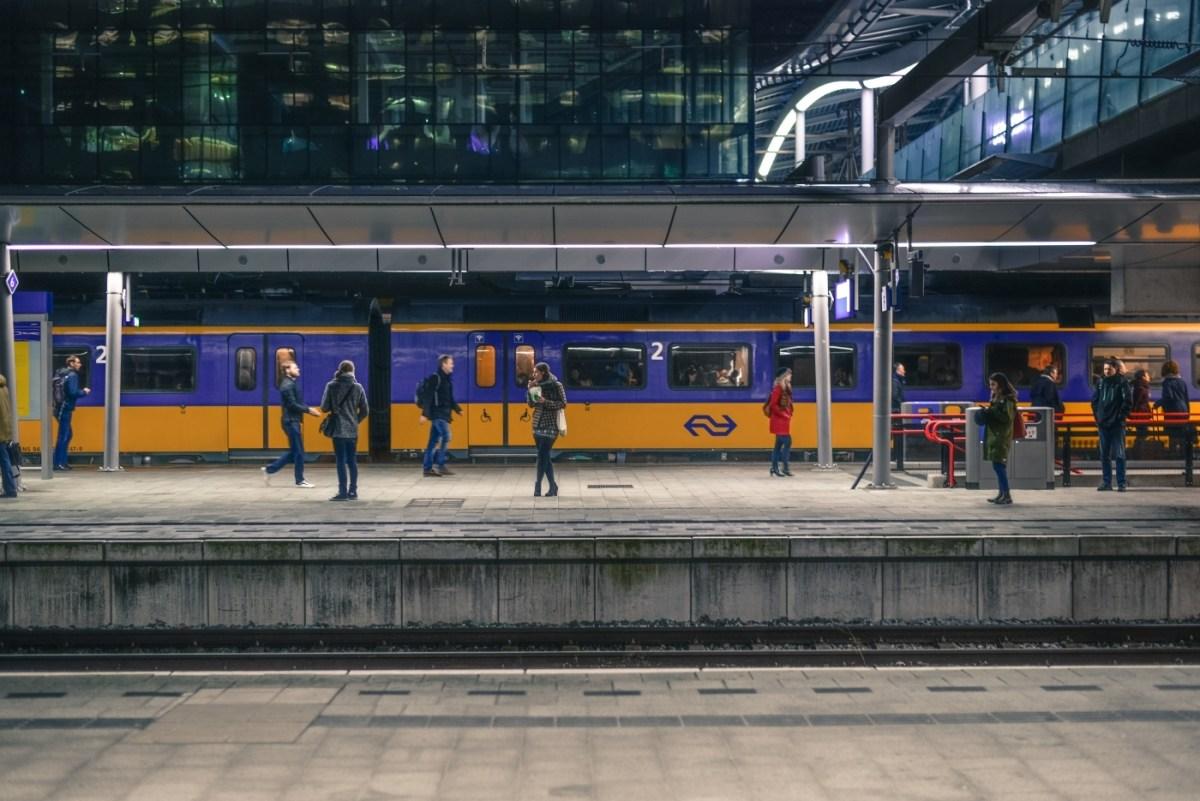 Passengers walking on train platform