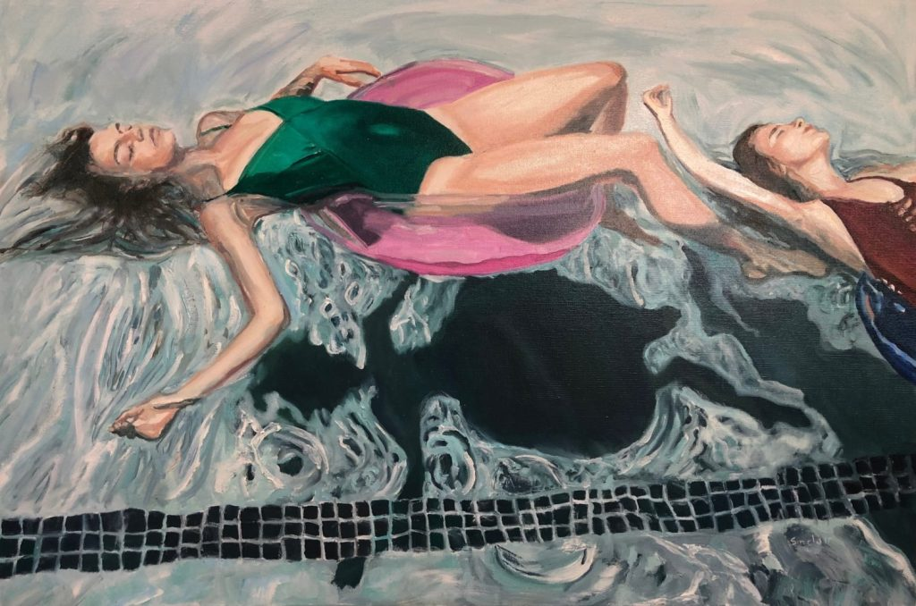 woman on float in swimming pool