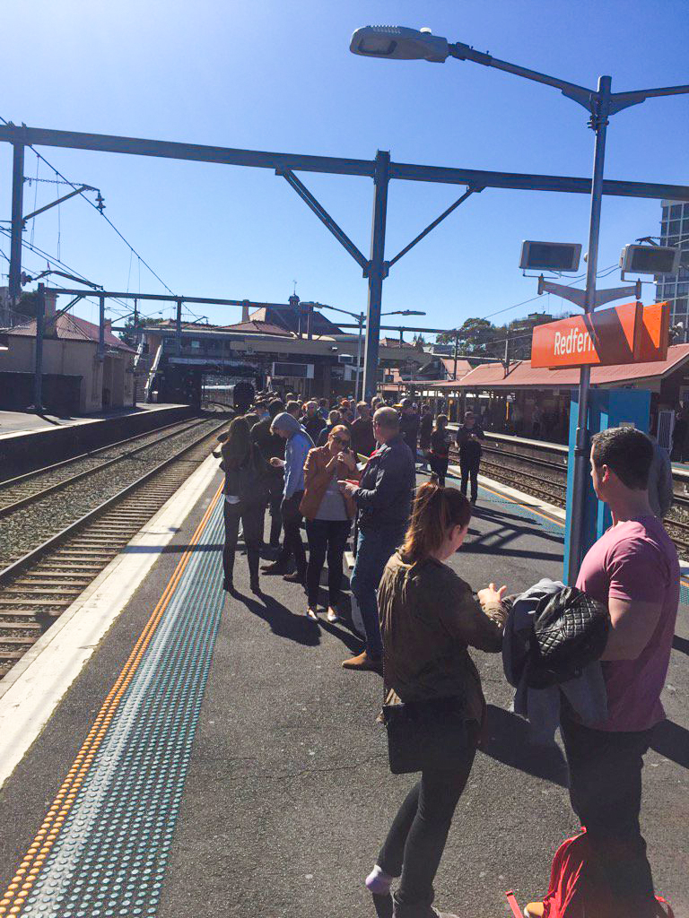 Hundreds of college football fans packed Redfern station to head out to Olympic Park on Saturday