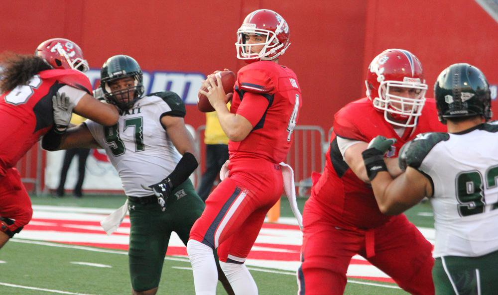 Fmr Fresno State QB Derek Carr in action against Hawaii in 2012. He's playing good football with Oakland in the NFL these days. Photo: Jodie Newell
