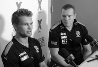 Tigers Dan Butler & Justin Leppitsch post-game at the Sydney AFLX. tournament. Photo: Jodie Newell