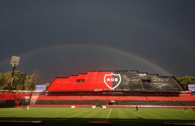 Estadio Marcelo Bielsa on a dark day with a rainbow overhead