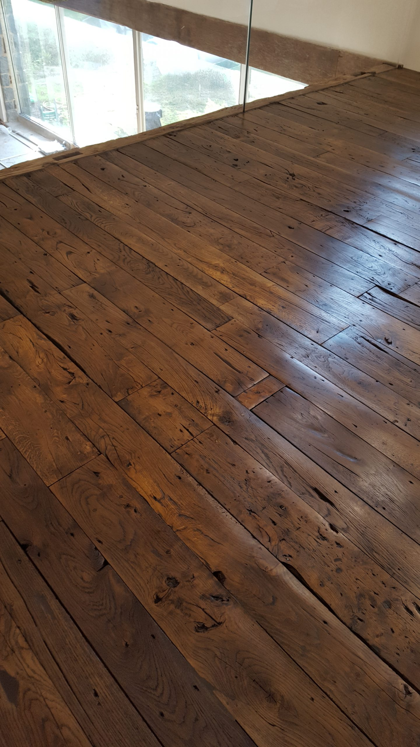 Beautiful reclaimed French oak floorboards shellacked and waxed
