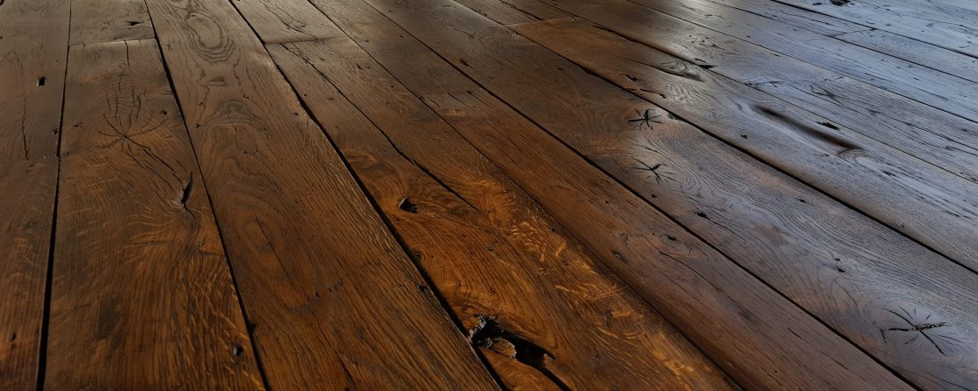 400 year old reclaimed French oak from tank garrison, sanded, stained and waxed
