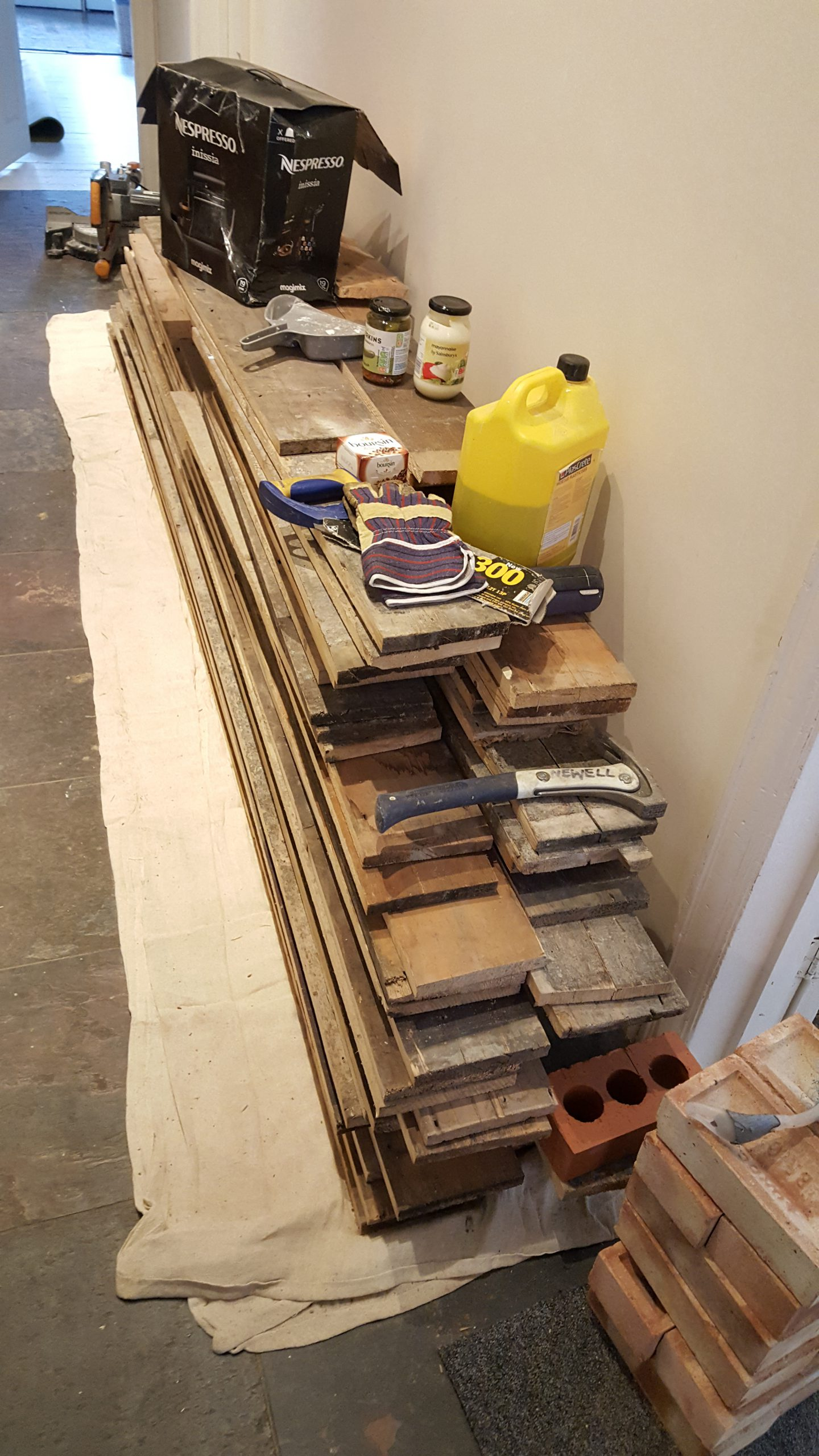 Reclaimed pine floor boards stacked ready to fit
