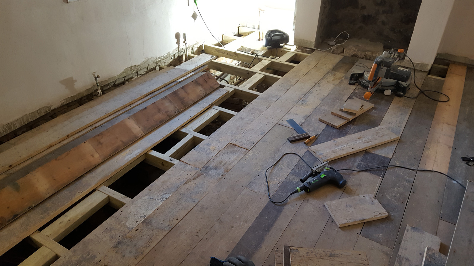 reclaimed pine floor being installed