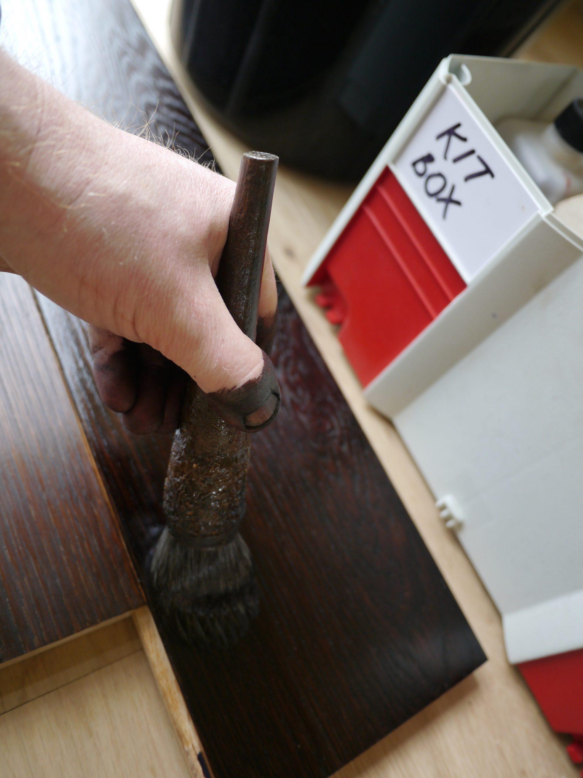 Brushing on colour sample on Engineered oak floor