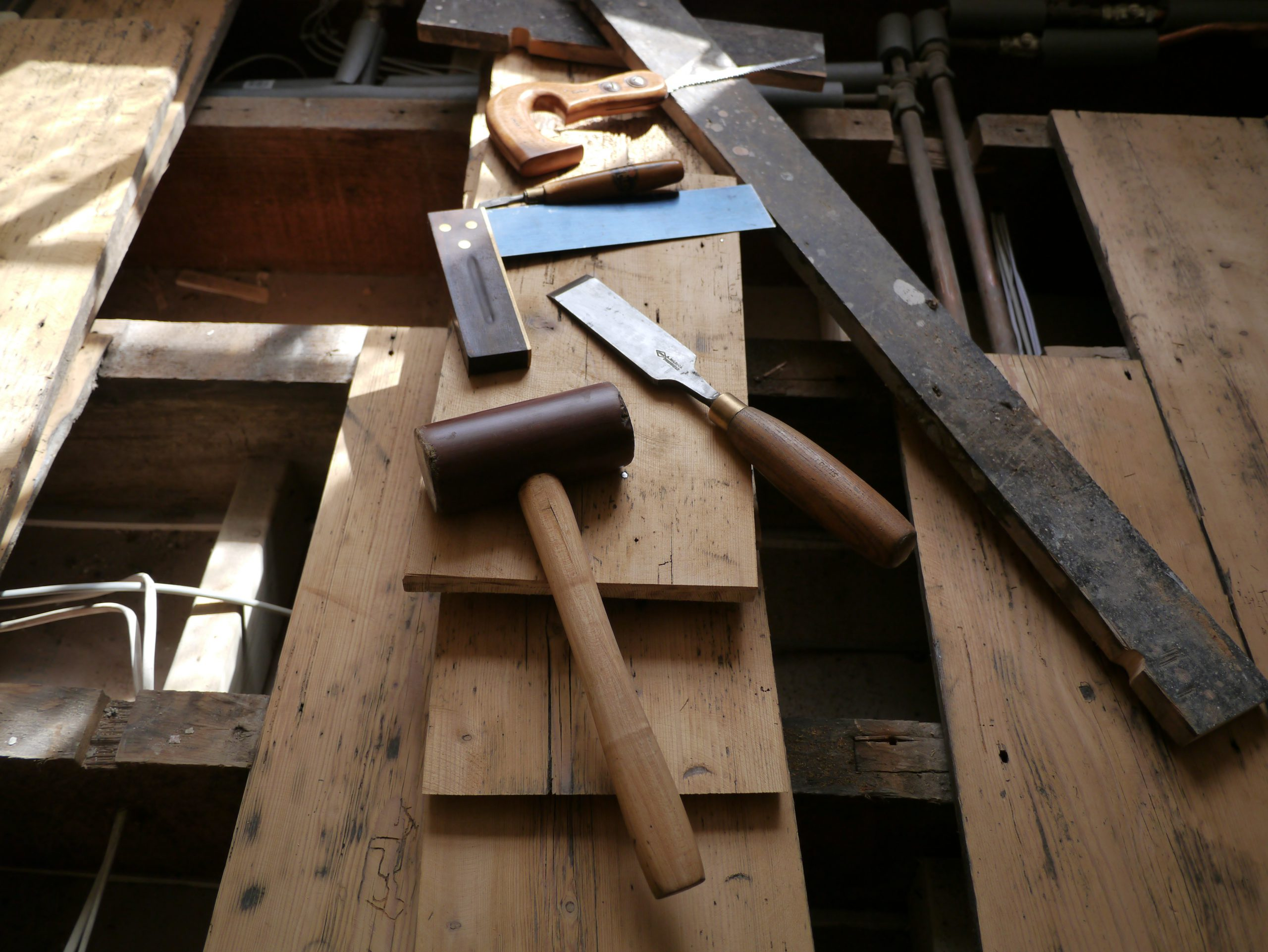 Traditional hand tools on 300 year old pine cottage floor boards